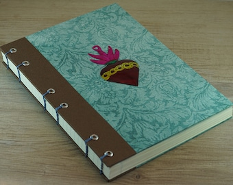 Coptic binding travel journal with brass heart