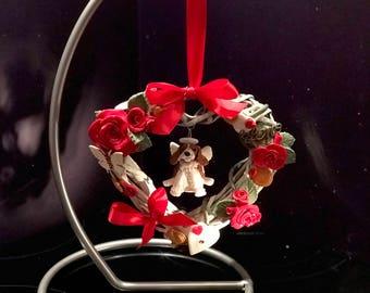 Bespoke dog cat pet sculpture in decorated heart wreath