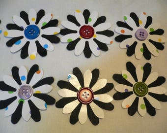 Daisy Shaped Flowers, Layer of White with Polka Dots Heavy weight paper and Black med weight paper w/a Button Center.  18 Flowers