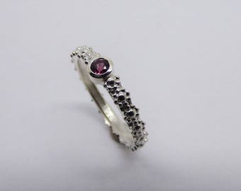 Floral ring with garnet