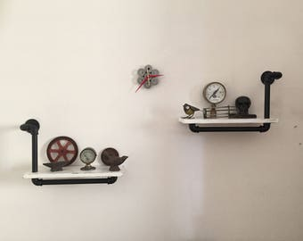 Couple of shelves in hydraulic pipes industrial style