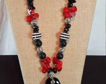 Awesome red, white and black necklace with fabulous black pendant