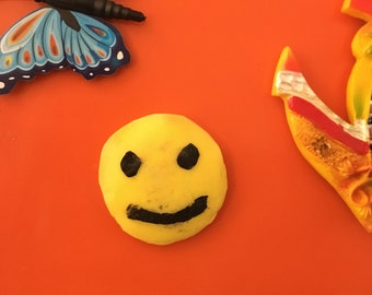 Recycled Smiley face fridge magnet