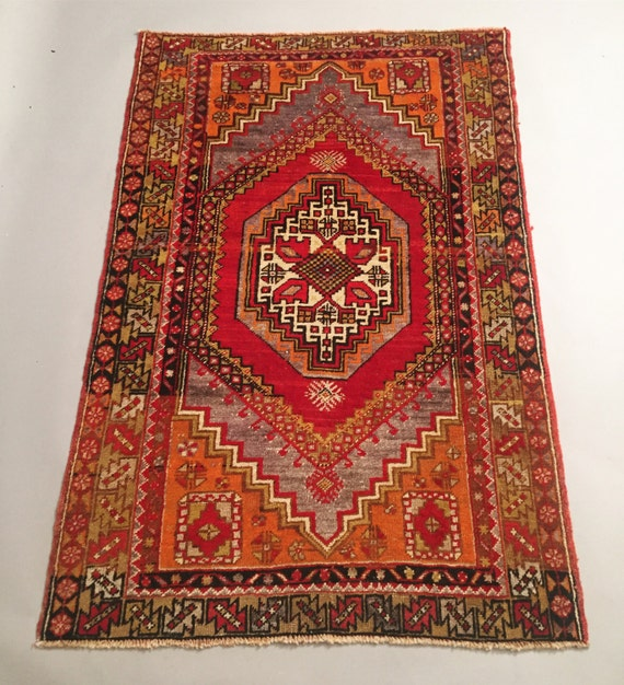 Handmade Turkish vintage rug with beautiful colors from orange, Red, Black and grey.