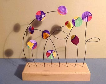 Flight of flower buds multicolored paper