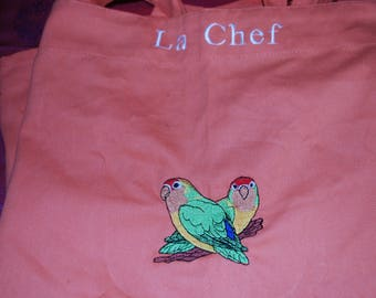 """Apron woman """"chef"""" with exotic birds"""