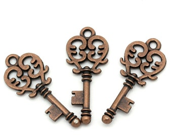 5 Antiqued Copper  Filigree Key Charms
