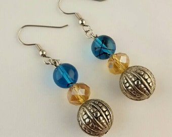 Dangle 3 bead earrings with turquoise and amber colored beads along with a stainless steel bead.