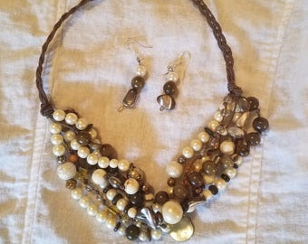 Hemp and bead 6 strand mat inee lenghth necklace.Matching earrings.