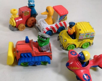 Collection Of 6 Sesame Street Muppet Figures And Their Vehicles/Playskool Cast Iron/Made In China