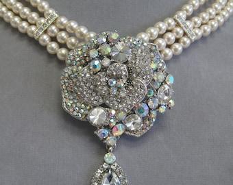 Three strand Swarovski pearl bridal necklace with crystal rhinestone focal.