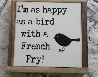 Happy as a bird with a french fry.