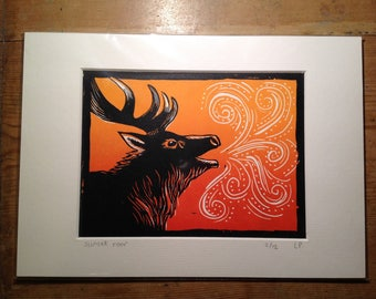 Roaring stag at sunset original lino print