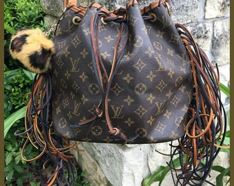 Louis Vuitton Petit Noe upcycled with fringe, pom pom and optional personalized strap.