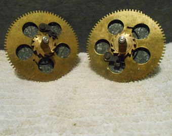 Two (2) spring gears from a mantle clock