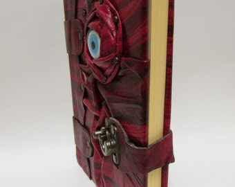 Leather journal notebook with eye emblem