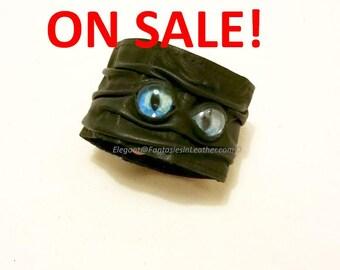 Blue Eyed Monster Wrist Band Cuff - Black Leather (JWL131)