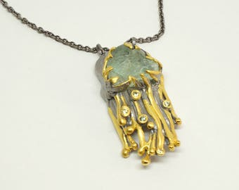 Pendant of Wolbeek jewellery with rough Schweizer Fluorite from the collection: Swiss rocks