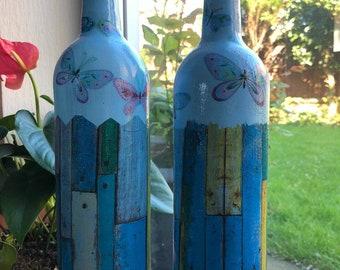 Upcycled glass bottles,decoupaged