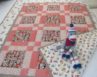 Sock monkey quilt crib quilt or for use at naptime at school.