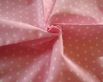 Fabric cotton pink background with white polka dots
