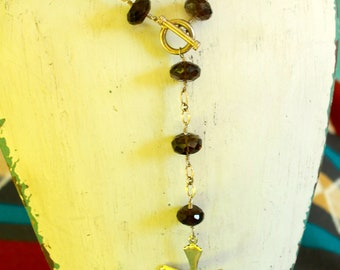 Handmade sterling silver chain, cross and faceted smoky quartz beads with sterling silver clasp.