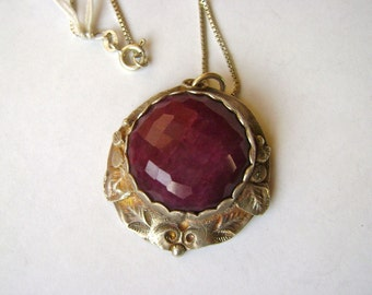 a pendant necklace:  fine silver and pink ruby beryl
