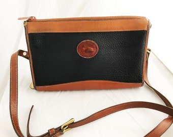Purse - Medium Dooney Bourke All Weather Leather Rectangular Handbag over the shoulder with adjustable strap