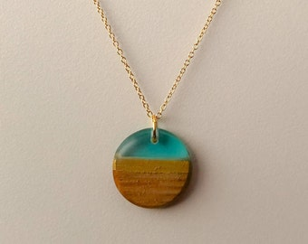 Dainty wood resin pendant on a gold filled chain