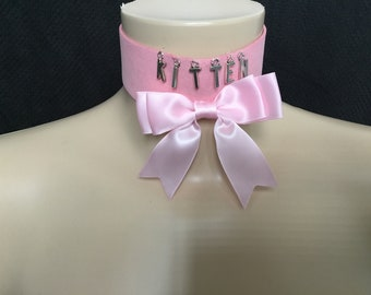 Cute pink choker collar, with bow and kitten wording.Kitten play.