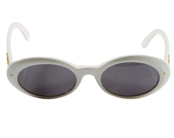 Vintage cat eye 80s sunglasses, made in Italy by Sting. White oval vintage sunglasses - 100% original never worn vintage accessory