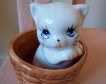 little white kitten in a basket figurine