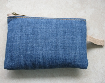 padded zipper pouch in blue denim with twill grab strap