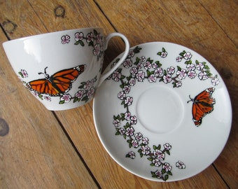 Hand painted butterfly, cherry blossom tea cup and saucer