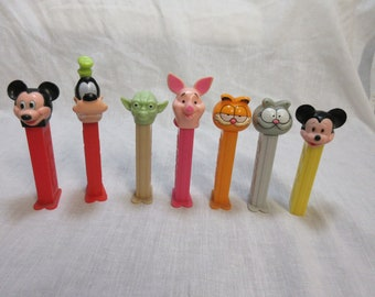 Seven Vintage Pez Candy Containers 70,s 80,s
