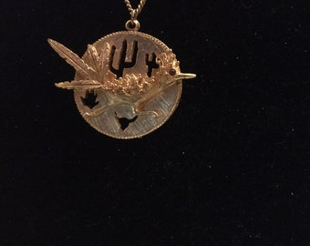 Roadrunner disc with cutouts necklace
