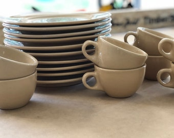 Beige Tepco restaurant ware dinner plates and cups