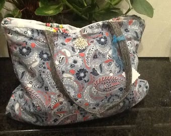 Blue flowery tote bag with glitzy embellishment to front