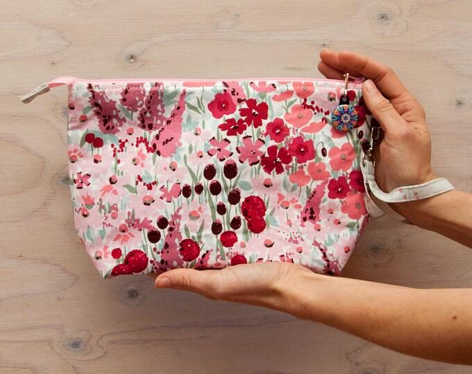 Knitting project bag, floral print, pink bag, red bag, crochet bag, medium bag, wrist strap, zipper pull, lined bag, project bag