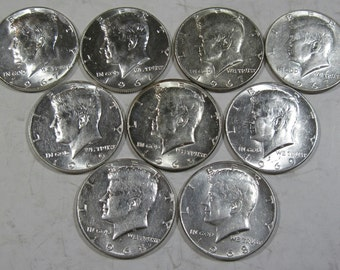 You get all nine shown 40% silver Kennedy halves. (#811a)