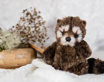 Raccoon teddy 16 cm.