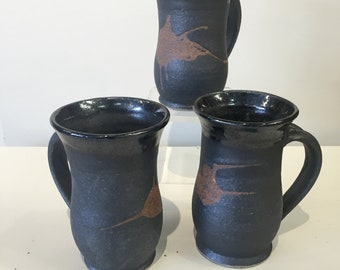 Black mug with exposed red clay