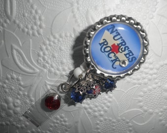 "Nurses Rock - Professional Retracrable ID Badge Reel With ""Nurses Rock"" on a Bottle Cap."