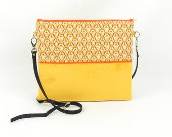 Yellow velvet clutch bag