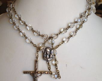 vintage rosary prayer beads with cross and connector in silvertone and faceted round glass crystal beads. made in italy circa 1970.