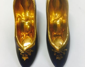 Two miniature dark blue Limoges shoes