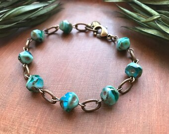 Aqua Blue Swirl Czech Glass Rock Bead Bracelet - Turquoise Hues and Rustic Bronze by Vintage Earth Jewelry