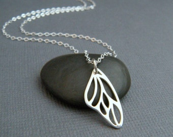 silver butterfly wing necklace. sterling silver. modern simple jewelry. everyday. delicate. dainty. garden. nature. gardener gift for her