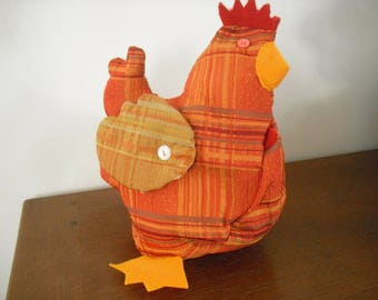 small decorative hen wedge is made of fabric Scottish rust Orange and brown tones