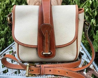 Vintage Dooney and Bourke All Weather Leather Marble Saddle bag bone and british tan color